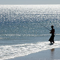 Silhouette Of A Man Fishing by Anthony Totah