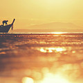 Silhouette Of A Thai Fisherman Wooden Boat Longtail During Beautiful Sunrise by Srdjan Kirtic