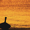 Silhouette Of A Thai Wooden Boat  On The Beach Against Golden Sunset Koh Lanta, Thailand by Srdjan Kirtic