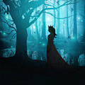 Silhouette Of A Womanin In A Forest At Twilight by Sandra Cunningham
