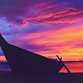 Silhouette Of A Wooden Thai Boat  On The Beach During Beautiful And Dramatic Sunset by Srdjan Kirtic