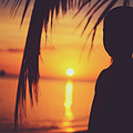 Silhouette Of A Young Boy Watching Beautiful Caribbean Sunset by Srdjan Kirtic