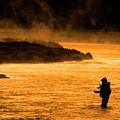 Silhouette Of Man Flyfishing Fishing In River Golden Sunlight by Lane Erickson