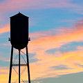 Silhouette Of Small Town Water Tower by Todd Klassy