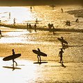 Silhouette Of Surfers At Sunset by Curtis Patterson