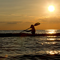 Silhouette Of Woman Kayaking In The Ocean. by Anthony Totah