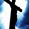 Silhouetted Crucifix Against A Cloudy Sky by Sami Sarkis