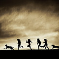 Silhouettes Of Running Girls And Dogs  by Maggie McCall