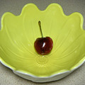 Single Cherry In A Bowl by Lucyna A M Green