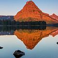Sinopah Mountain Reflected In Two Medicine Lake At Sunrise by Craig Tata