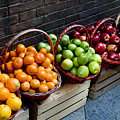 Six Baskets Of Assorted Fresh Fruit by Todd Gipstein