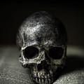 Skull On Book by Edward Fielding