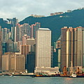 Skyline From Kowloon With Victoria Peak In The Background In Hong Kong by Sami Sarkis