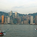 Skyline From Kowloon With Victoria Peak In The Background by Sami Sarkis