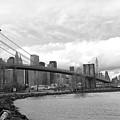 Skyline Nyc Brooklyn Bridge Bw by Chuck Kuhn