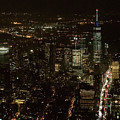 Skyline Of New York City - Lower Manhattan Night Aerial by David Oppenheimer