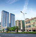 Skyscrapers And Road In Downtown Xiamen City China by Jacek Malipan