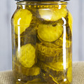 Sliced Pickles In Clear Glass Jar by Donald  Erickson