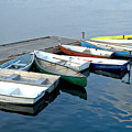 Small Boats Docked To A Pier by Olivier Le Queinec