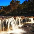 Small Waterfall In Australian Landscape  by David Trent