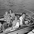 Smiling Family In Docked Boat, C.1960s by H. Armstrong Roberts/ClassicStock