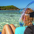 Snorkeler Relaxing On Tropical Beach by Benny Marty