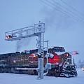 Snowy Train Crossing  by Dutch Bieber