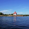 Snug Harbour Lighthouse by Debbie Oppermann