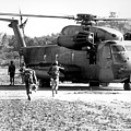 Soldiers Run To A Hh-53c Helicopter by Stocktrek Images