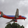 Southwest Airlines 737 On Approach Into Las Vegas Nv by Carl Deaville
