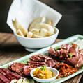 Spanish Smoked Meats Ham And Cheese Platter Starter Dish by Jacek Malipan