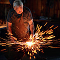 Sparks When Blacksmith Hit Hot Iron by Johan Swanepoel