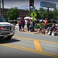 Spectators At A Parade  by Frank J Casella