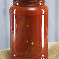 Spicy Salsa In Clear Glass Jar by Donald  Erickson