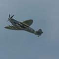 Spitfire In Flight by Philip Pound