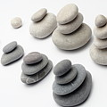 Stacks Of White And Gray Pebbles by Sami Sarkis