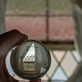 Stained Glass Window With Curtains In Crystal Ball by Karen Foley