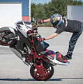 Standing On One Leg Riding Wheelie by Tony Fruciano
