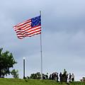 Star Spangled Banner Flag Flying Over Federal Hill Baltimore by James Brunker