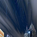 Star Trails And City Lights by Brad Boland