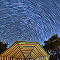 Star Trails Over The Umbrellas by Mimi Ditchie