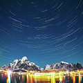 Startrails Above Reine by Alex Conu