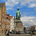 Statue Of Jan Van Eyck Beside The Spieglerei Canal In Bruges by Louise Heusinkveld