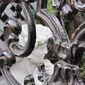 Statue Through A French Quarter Gate by Jan Prewett