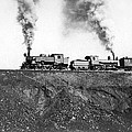Steam Engines Pulling A Train by Underwood Archives