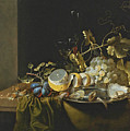 Still Life Of Hazelnuts Grapes Oysters And Other Foods On A Draped Table by Laurens Craen
