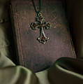 Still Life With An Old Book And Cross Pendant by Jaroslaw Blaminsky