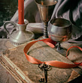Still Life With Old Book And Metal Dishes by Jaroslaw Blaminsky