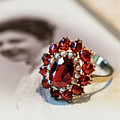 Still Life With Old Photo And Ruby Stoned Ring by Jaroslaw Blaminsky