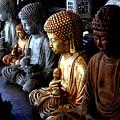 Stone Buddhas by Christine Sullivan Cuozzo